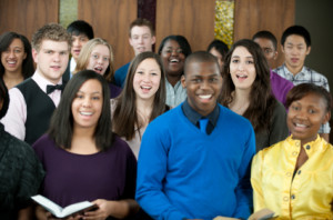 A diverse group of young adults singing in church.
