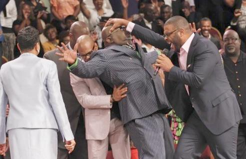 Tyler Perry Lays hands on Bishop T D  Jakes!