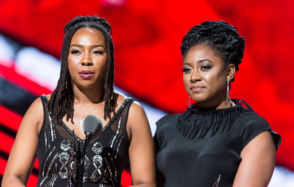 NEWARK, NEW JERSEY - APRIL 01: Black Lives Matter founders and Change Agent Award recipient's Opall Tometi and Alicia Garza speak onstage during BET Black Girls Rock! 2016 at New Jersey Performing Arts Center on April 1, 2016 in Newark, New Jersey. (Photo by Gilbert Carrasquillo/FilmMagic)
